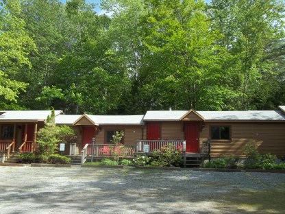 Cottage rooms with private front porches at Wiscasset Woods Lodge in Midcoast Maine.