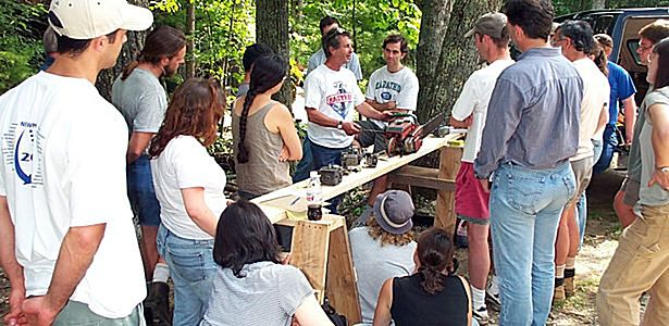 Students gather around to learn the use of woodworking tools at the Shelter Institute in Maine