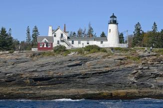 Pemaquid Point Light House, the most photographed lighthouse in Maine with dramatic rocks going to the ocean.