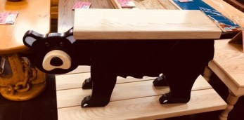 Wooden bear table made at the Prison Store in Thomaston. Inmates learn woodworking skills to help them find work after release.