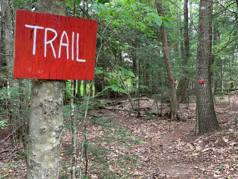 Sign to the trail at Wiscasset Woods Lodge, takes guests through our eight acres of woodlands.